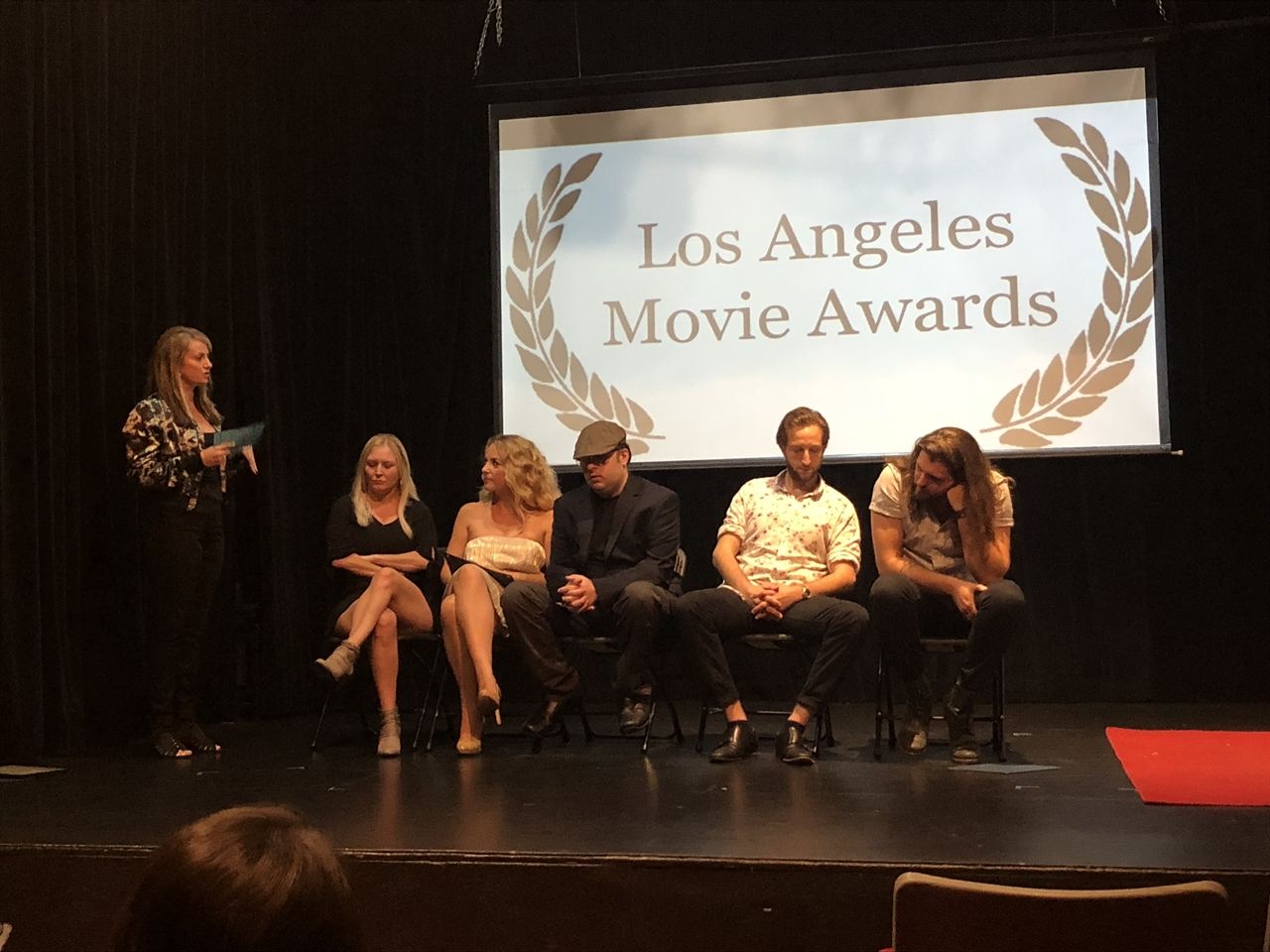 Janine on stage with the cast and crew for a Q&A for their film F***, Marry, Kill at LA Movie Awards in Sept' 2018
