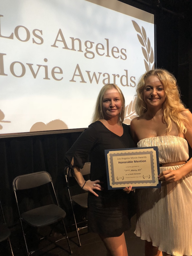 Janine with fellow producer and actress Rachel Ryling receiving the award 'Honorable Mention' for their film F***, Marry, Kill at  LA Movie Awards in Sept' 2018
